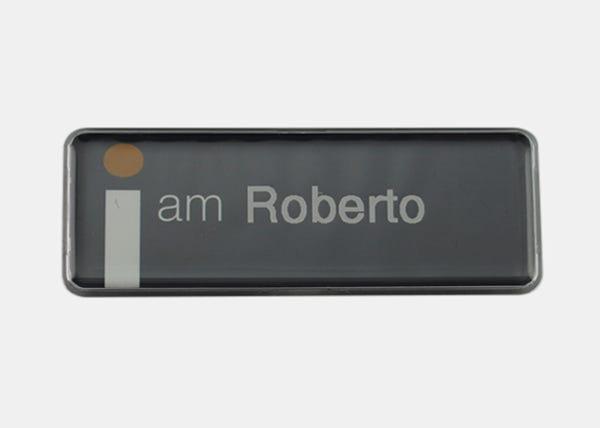 black rectangle name badge
